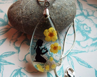 Yellow petal resin pendant
