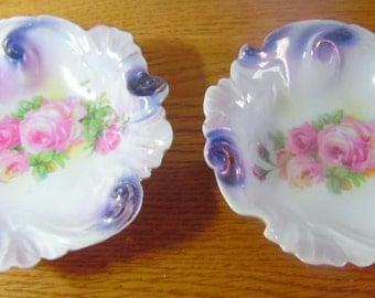 Pair of hand painted, porcelain pin dishes, dresser dishes, with pink roses and decorative edging.