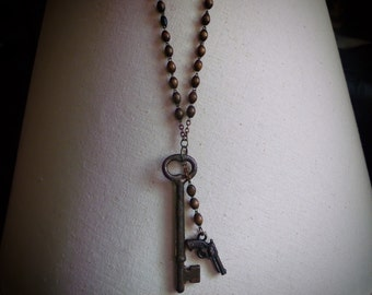 Rosary Style Beaded Antique Key and Pistol Necklace