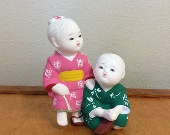 Genuine Hakata Doll Figurine - Japan Ceramic - Man helping Woman with Shoe