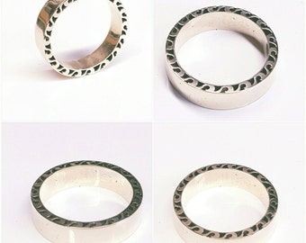 Handmade wedding ring representing waves of the sea