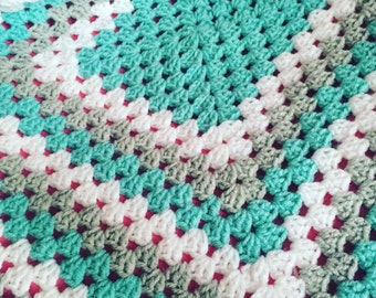 Multicoloured granny square baby blanket