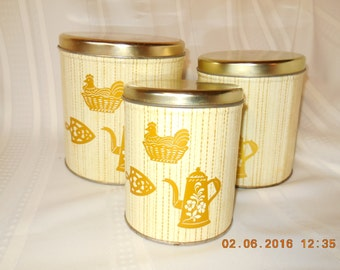 Vintage metal canister set, set of three yellow and gold.