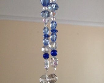 Angel Sun Catcher, blue and clear crystals, 9 inches in length, religious, faith , hope, love.
