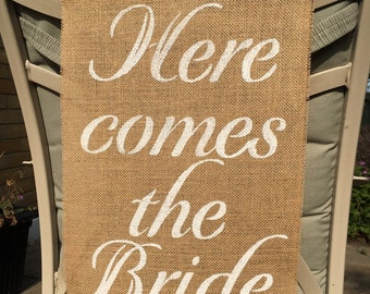 Here Comes the Bride burlap hessian banner. Beautiful addition to their wedding day.