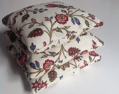 Set of 3 lavender sachets in floral fabric.