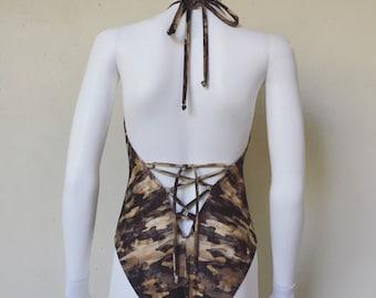 Camouflage print bodysuit.