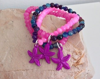 Charm Bracelet purple starfish, glass beads,stretchy bracelet.