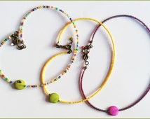 Necklaces for girls from 4 years old. Glass pearls, mother of pearls green apple or fuschia and sunsbathes aged clasp.