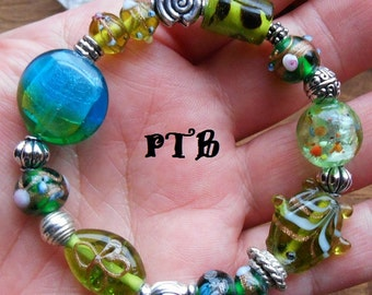 "Money/Luck ~ Authentic Green Lampwork Glass beaded stretch Bracelet 7 1/2"""