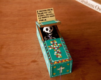 Mexican Day of the Dead decorations / coffin with flowers