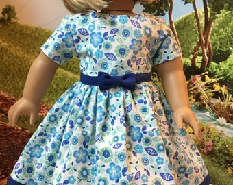18in doll dress. Fits dolls like American Girl and others.  Adorable blue flower print/dk blue accents