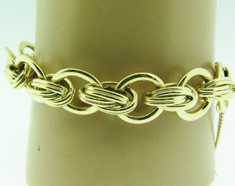 "Vintage 14 karat gold 8"" long bracelet with safety chain."