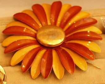 Vintage enamel Daisy pin vibrant orange hues brooch
