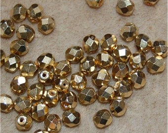 FIRE POLISH BEADS, a mix of 2 sizes, Metallic Gold, sold in units of 50 @ 6mm and 100 @ 4mm, a total of 150 fire polish beads.