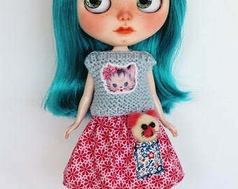 Hand knitting sweater with skirt for Blythe