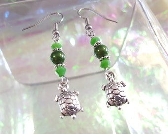 TURTLE, dangling earrings with beads in shades of green.
