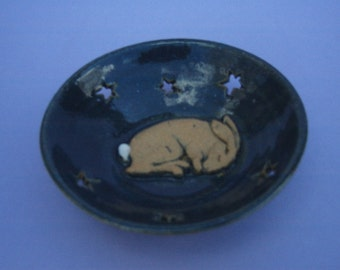 Hand thrown stoneware dish with sleepy hare and cutout stars