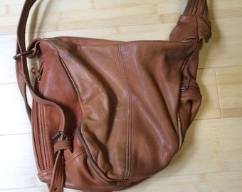 Yummy soft caramel leather hobo bag. Lots of zippers.