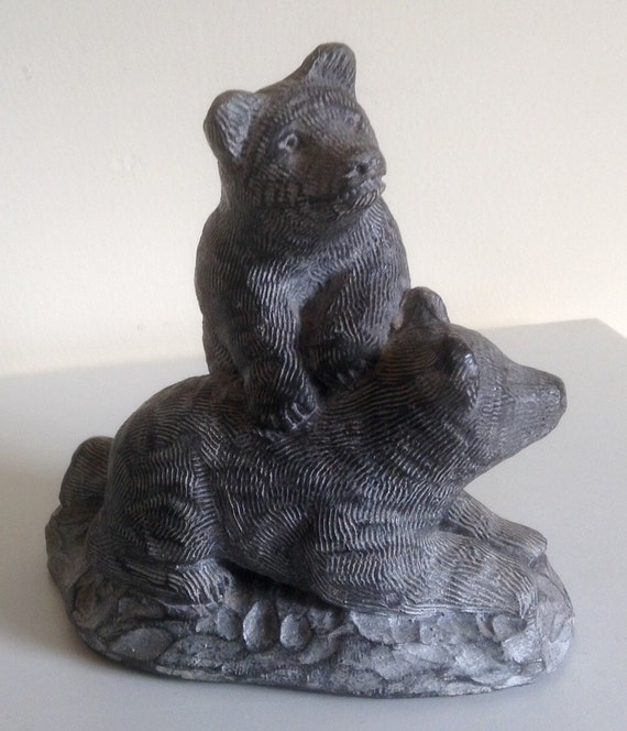 Vintage carving of two bear cubs by wolf canada in