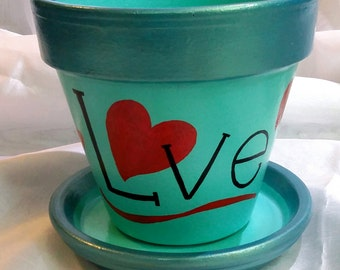 LOVE is all you need.  This planter was hand painted with lots of it. A great gift idea for any occasion.  Use at home or or office.