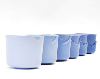 Handmade porcelain cups in blue and white with goldluster