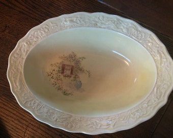 Vintage cream/oval serving bowl with rose vine and window