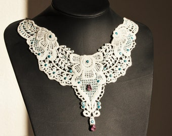 White lace necklace with blue and pink stones