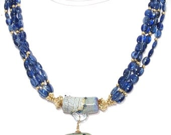 BN049- Four-strand Blue Kyanite and Gold necklace with fancy two-part Lampwork Glass bead