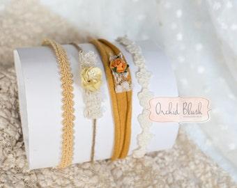Handmade Set of 4 Newborn headbands/tiebacks. Mustard/cream florals, photo prop