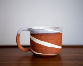 handmade white and red marbled clay coffee mug