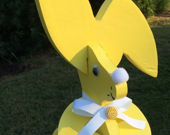Easter rabbit in a soft yellow, pretty white ribbon, nose and cottontail, accented by crocheted yellow button  24.95