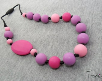 Asymmetrical pink teething, babywearing and nursing silicone necklace