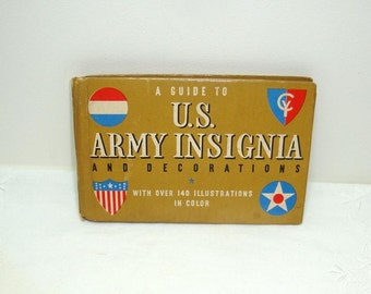 A Guide To US Army Insignia and Decorations from 1941. Has over 140 illustrations in color. Little book has 62 pages bound with string.
