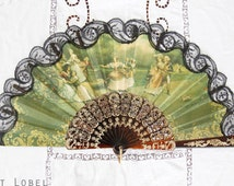 Hand Fan, featuring a beautifully elegant Rococo-group, playing Blind Man's Buff, goldcolor accents on black lace edges, signed