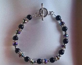 Black , metalic and diamante sparkle bracelet.