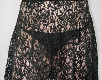 Sheer lace skirt, unlined, lightly flared, elastic waist