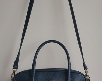 Vintage women's blue leather handbag by Chaus