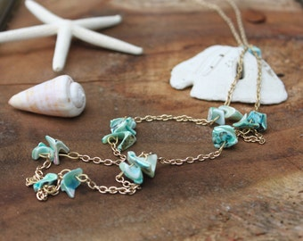 Blue stained conch on gold chain