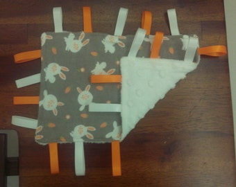 Taggie blanket - Minky and Flannelette, white and orange rabbits