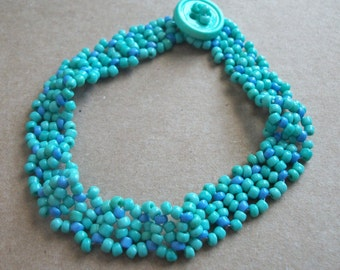 Turquoise Green Feather beaded bracelet