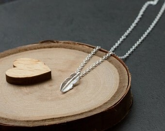 Small Silver Feather Necklace. Petite sterling silver feather pendant.