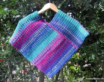 Child's poncho (Mac's poncho). Purple poncho, blue poncho. Knit in wool / acrylic mix. Reversible.
