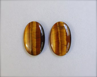 Tiger eye cabochon matched pair. Large oval stones.