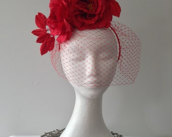 Red roses and veiling fascinator headpiece