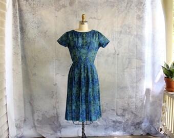 blue 1960s dress with India inspired print . pleated skirt shirtwaist dress by Meg Marlowe . womens size small . semi sheer 50s 60s dress