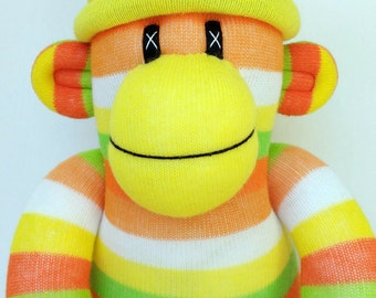 Sock monkey soft toy - bright citrus yellow lime and orange stripes with removable pom pom hat ce certified