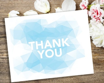 Printable thank you card with geometric blue pattern and bold white thank you print at home