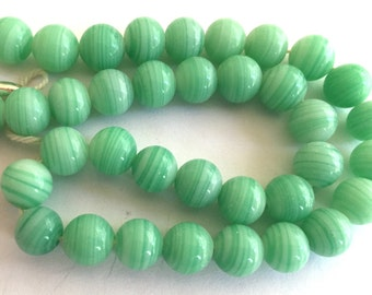 Vintage Japanese beads (20) polished light Jade green faint white stripes opaque glass Occupied Japan cherry brand rounds 8mm (20)
