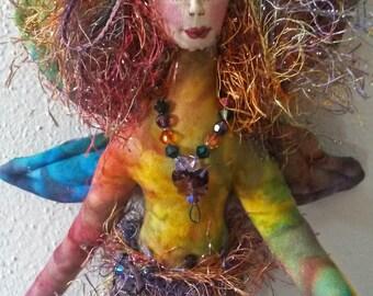 Whimsical fiber sculpted fairy wall sculpture